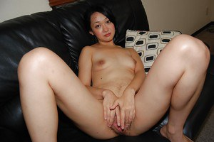Shy asian chick strips down and gets her hairy pussy fingered