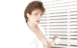 Mature fetish lady in nylons and glasses has some nipples pumping fun