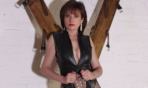 Mature fetish chick in provocative outfit flashing her tits and fanny