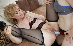 Lecherous mature sluts make some steamy lesbian action with a strapon