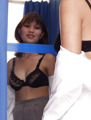 Naughty tai floosie demonstrating her goods in the changing room