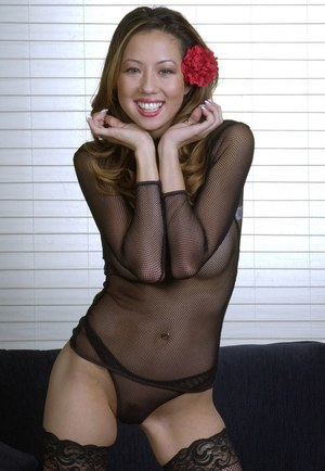 Slender thai temptress in stockings slipping off her sheer lingerie