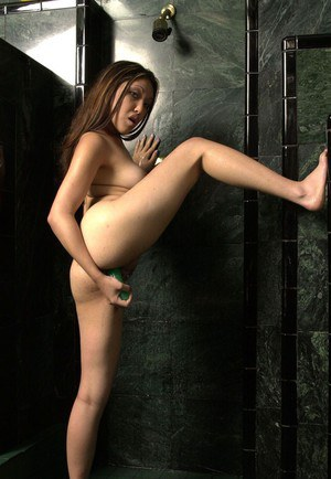 Seductive thai slut toying her shaved cunt in the shower room