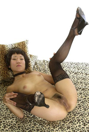 Slim asian girl taking off her lingerie and spreading her legs in stockings