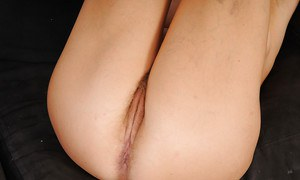 Smiley mature lady undressing and exposing her hairy cooter