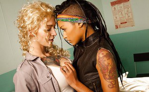Tattooed blonde hottie has some lesbian fun with her sexy ebony friend