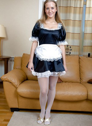 Foxy blonde maid in white stockings taking off her panties and toying her ass