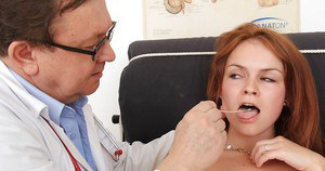 Naughty redhead floosie gets involved into kinky gyno exam action