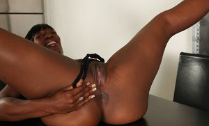 Mature, ebony vixen with tiny tits shows what hides beneath her skirt