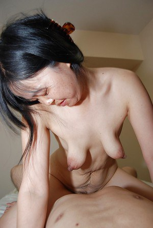 Hairy, mature Asian courtesan licks balls and rides big prick