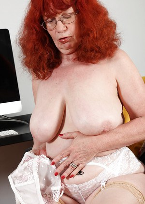 Sexy, red-head, mature secretary fondles her shaved cunt in office room