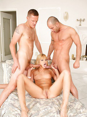 Slender European blonde gets penetrated from both sides by horny men