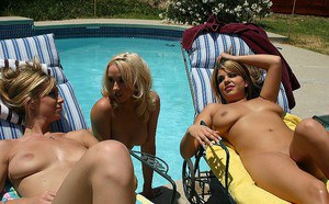 Tasty, oiled lesbians are having wild time outdoor over swimming pool