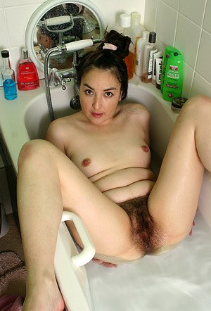 Pretty, charismatic Asian milf Dawn rinses her sweet, hairy bushes