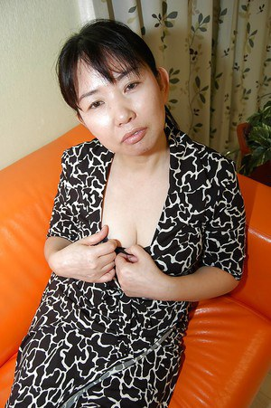Asian brunette Sumie Nagai makes a very nice hairy pussy presentation