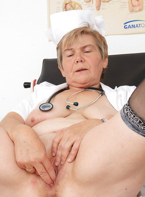 Mature slut in nurse uniform spends her spare time with dildo