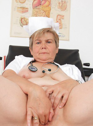 Mature fatty sits on chair and shoves fingers inside her twat