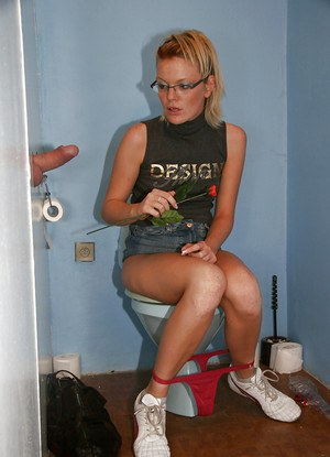 Geeky babe in glasses pisses in toilette room and swallows prick