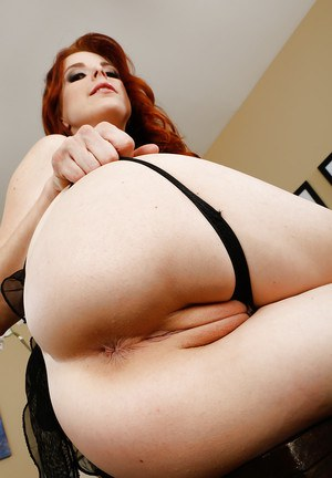 Redhead babe Penny Pax has the right mood for naked posing today