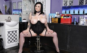 Tattooed fatty with big tits Scarlet LaVey poses over bar counter