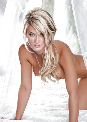 Blonde seductress with smoky eyes uncovering her ravishing curves