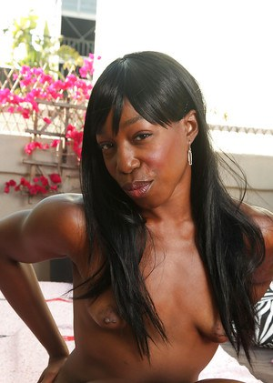 Awesome ebony female Pepper Deville poses in very sexy bikini
