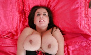 Fatty mature slut undresses to her lingerie and exposes her tits and cunt