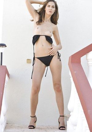 Graceful babe with long legs takes off her bikini and exposes her shaved slit