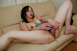 Lecherous asian mature lassie pleasing her hairy cunt with vibrators