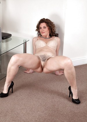 Mature European whore Sofia Matthews touches upon her hairy cootch