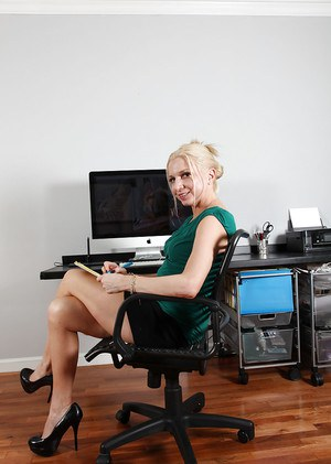 Mature office worker Jessica Taylor undresses in her private room