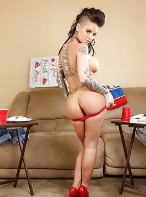 Tattooed pornstar babe Christy drives us crazy by posing in high-heels