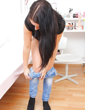 Busty gal in jeans undressing and stuffing her pink hole with gyno instruments