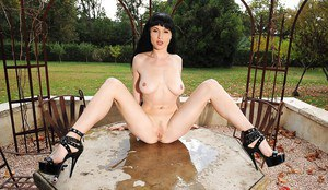 Bosomy brunette fetish seductress undressing and pissing outdoor