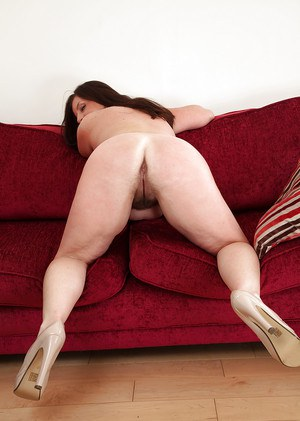 Fatty mature lassie with unshaven cunt undressing and spreading her legs