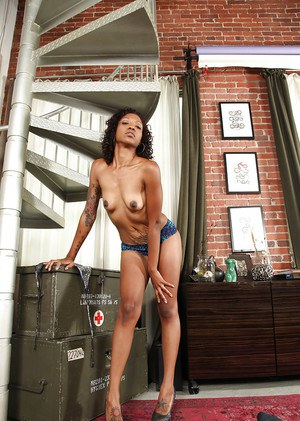 Pretty ebony babe Lotus Lain exposes dark, intimate spots of her body