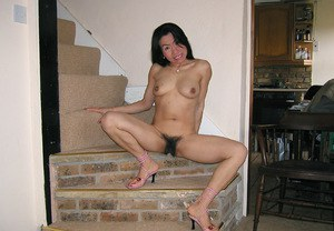 Lecherous asian MILF with shaggy twat undressing and exposing her goods
