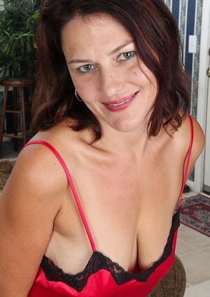 Mature Tugging Big Tits