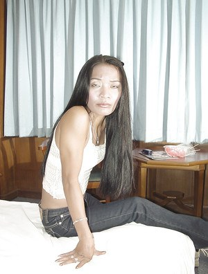 Skinny asian lassie in jeans gets talked into some stripping action