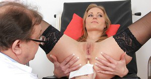 Graceful blonde sweetie in black stockings features in this gyno fetish scene