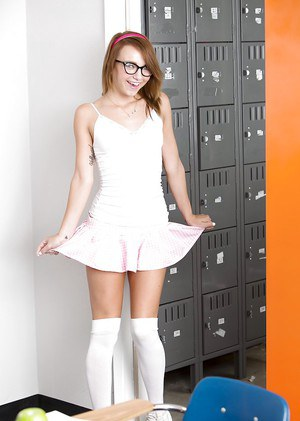 Perky schoolgirl in glasses undressing and exposing her slippy curves