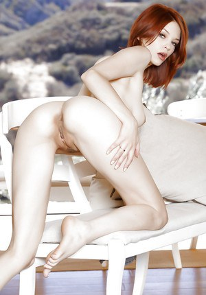 Playful redhead hottie getting nude and spreading her lower lips