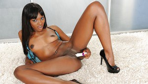 Smiley ebony sugar with slim body taking off her lingerie and toying her slit
