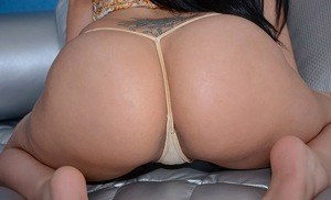 Smiley latina with ample booty undressing and spreading her pussy lips