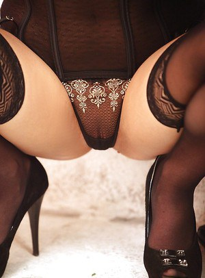Perky glamorous vixen in stockings revealing her ample bosoms