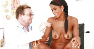 Graceful exotic hottie getting her pussy examed and pissing