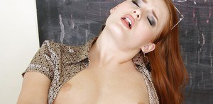 Sexy redhead teacher gets her pussy stretched up against the chalkboard
