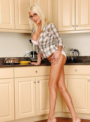 Naughty housewife in glasses Puma Swede undresses in kitchen room