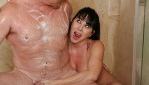 Independent milf with oiled big tits RayVeness massages hard-on buddy
