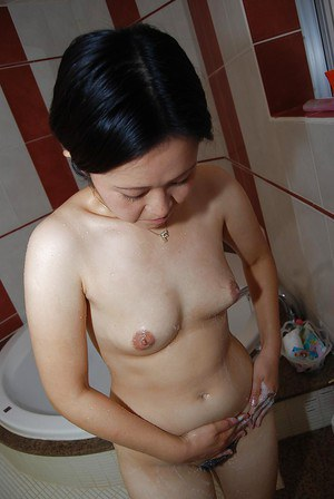 Appealing Asian milf Takako Makino rubs her ass and washes her tits